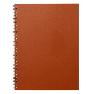 Reddish colored wood pattern notebooks