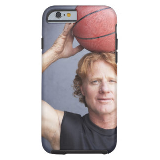 Redhead holding a basket ball over his head tough iPhone 6 case