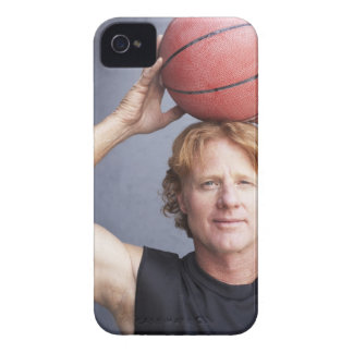 Redhead holding a basket ball over his head iPhone 4 Case-Mate cases