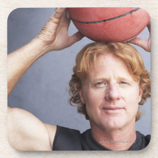 Redhead holding a basket ball over his head coaster