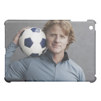 Redhead holding a soccer ball on his shoulder iPad mini covers