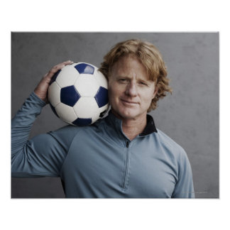 Redhead holding a soccer ball on his shoulder poster