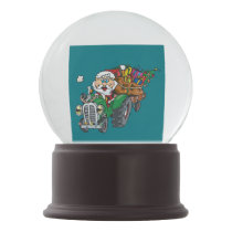 Redneck santa is coming to town on his tractor snow globe