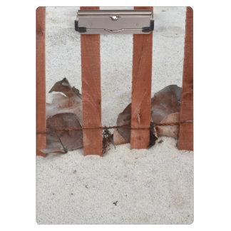 redwood fence sea grape leaves sand image clipboard