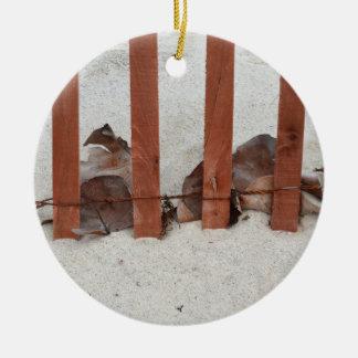 redwood fence sea grape leaves sand image ornaments