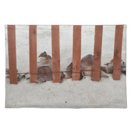 redwood fence sea grape leaves sand image placemat