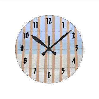 redwood lathe fence beach background round clock