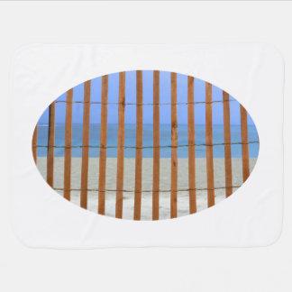 redwood lathe fence beach background stroller blanket