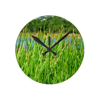 Reeds trees pond background round clock