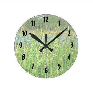 Reeds trees pond background wall clocks