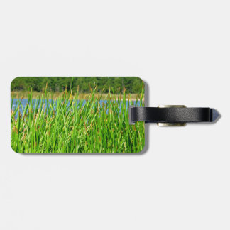 Reeds trees pond background luggage tag