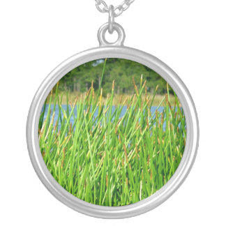 Reeds trees pond background necklaces