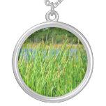 Reeds trees pond background pendant