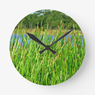 Reeds trees pond background round clock