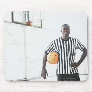 Referee holding basketball on court mouse pad