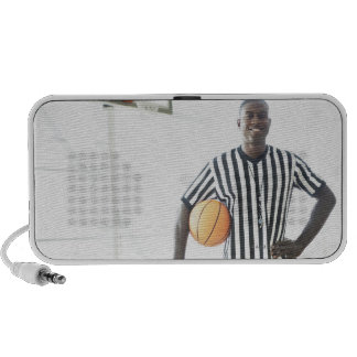 Referee holding basketball on court PC speakers
