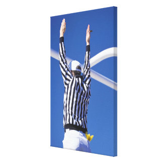 Referee signaling touchdown or successful field canvas print