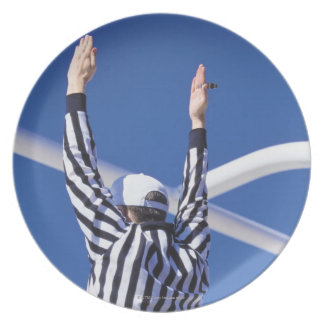 Referee signaling touchdown or successful field dinner plate