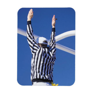 Referee signaling touchdown or successful field magnet