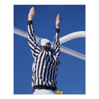 Referee signaling touchdown or successful field poster