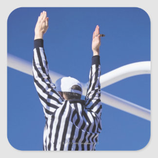 Referee signaling touchdown or successful field sticker