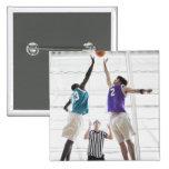 Referee watching basketball players jumping button