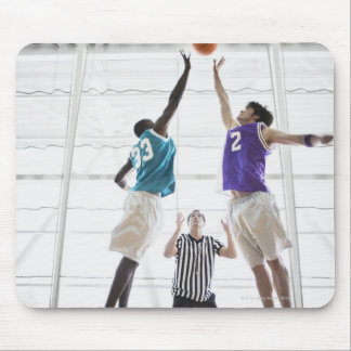 Referee watching basketball players jumping mouse pad