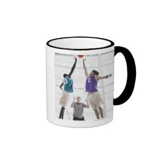 Referee watching basketball players jumping mug