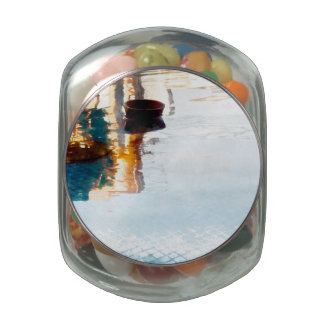 Reflection in water glass candy jar