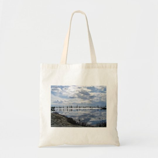 Reflection of clouds on water tote bag