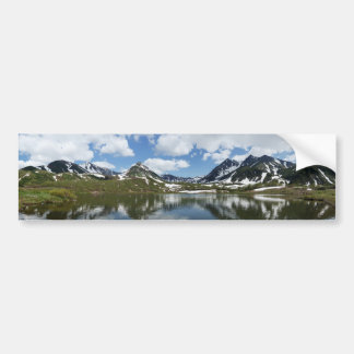 Reflection of sky and clouds in mountain lake bumper sticker