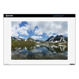 Reflection of sky and clouds in mountain lake laptop skins