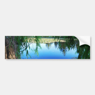 Reflections on a lake bumper sticker
