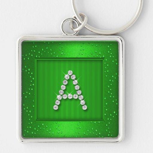 Reflejo y chispa verdes con el monograma llavero cuadrado plateado