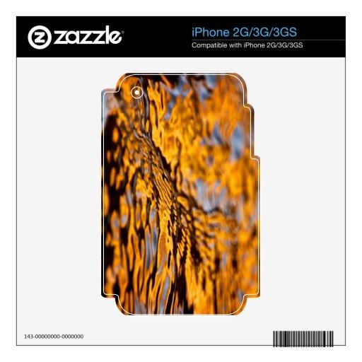 Reflexión anaranjada y púrpura skins para eliPhone 3GS