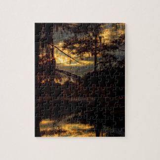 Reflexión de la puesta del sol del pantano rompecabezas con fotos