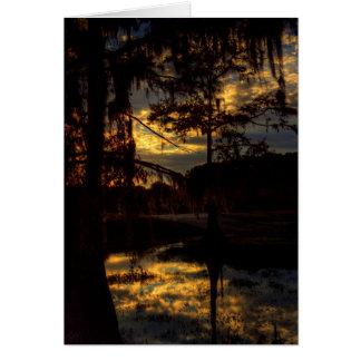 Reflexión de la puesta del sol del pantano tarjeta de felicitación