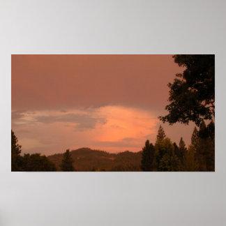 Reflexión de la puesta del sol posters