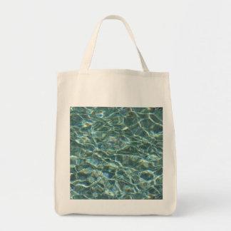 Reflexiones cristalinas de la superficie del agua bolsa tela para la compra