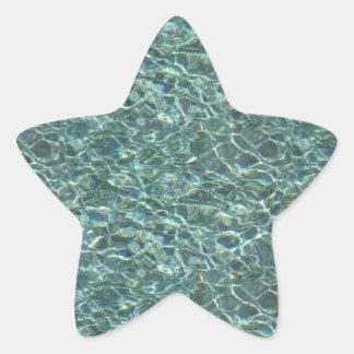 Reflexiones cristalinas de la superficie del agua pegatina en forma de estrella