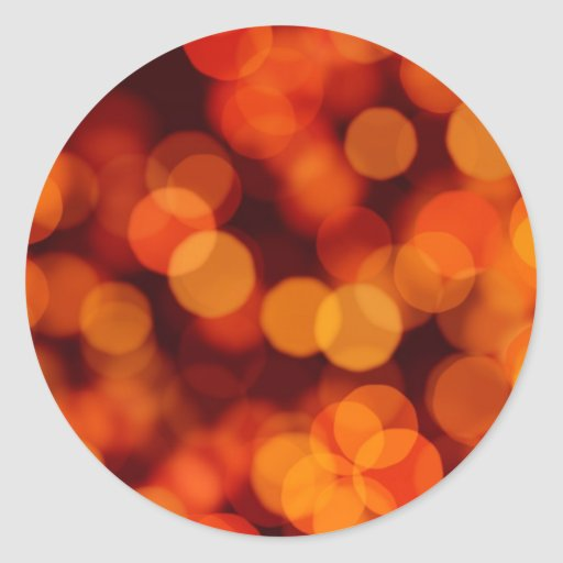 Reflexiones de la luz anaranjadas etiquetas redondas
