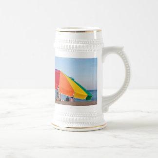refugio de la playa taza de café