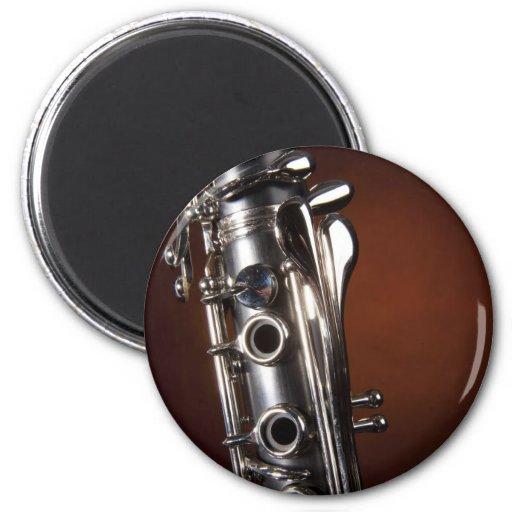 Regalo del Clarinet en fondo del proyector del oro Iman