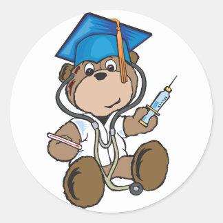 Regalos de la graduación de la enfermera y pegatina redonda