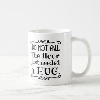Regalos divertidos del abrazo del piso taza de café