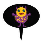 Regalos púrpuras amarillos de la criatura del mons palillos de tarta