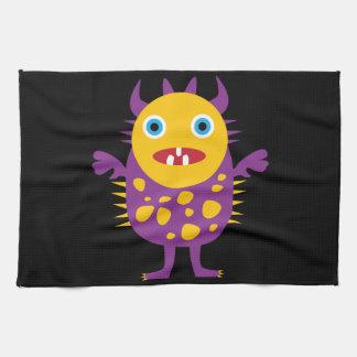 Regalos púrpuras amarillos de la criatura del mons toalla de cocina