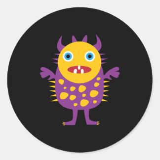 Regalos púrpuras amarillos de la criatura del mons etiquetas