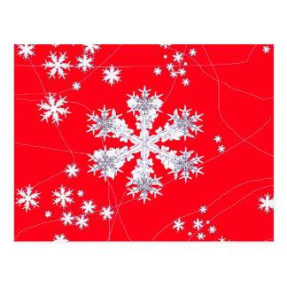 Regalos rojos de deriva de los copos de nieve por postal