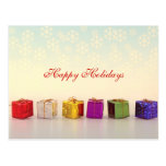 Regalos y copos de nieve del navidad postal